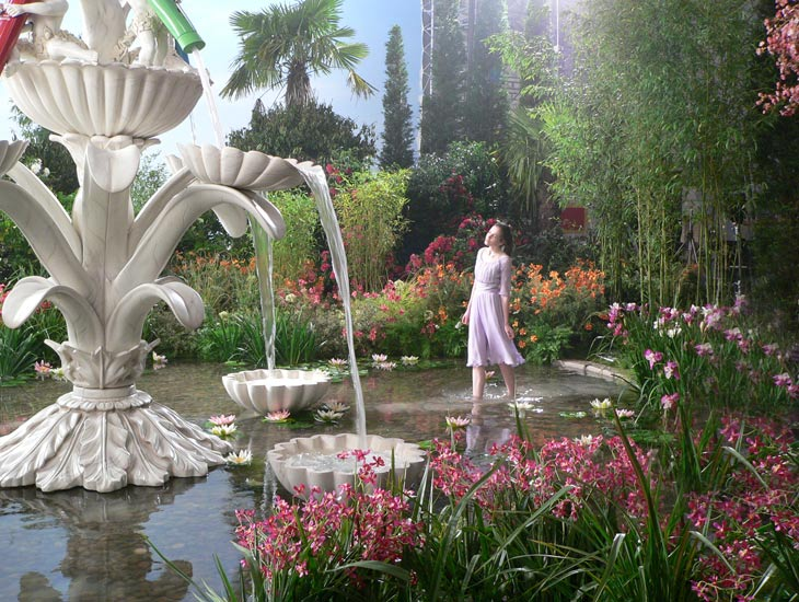 A combination of mature trees, plants and artificial flowers help to create this fantasy garden out of season during the winter.