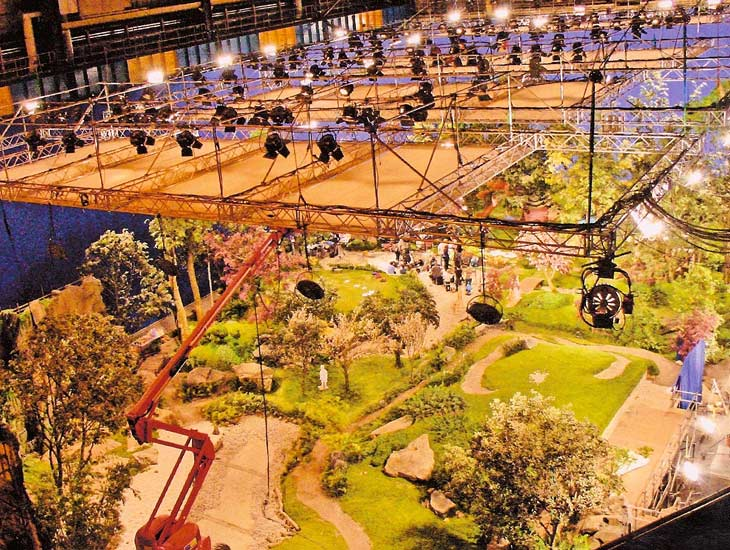 We spent six months creating this TV set which measured 135m x 41.5m and was built entirely using artificial foliage, plants and grass. The set incorporated 30 trees from 6m to 14m tall and 22,500 sprigs of artificial foliage were attached. The set also incorporated 1,000 tonnes of soil, 300 tonnes of stone boulders and slabs, and 1,300 square metres of artificial grass.